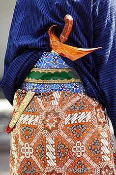 Photo about Indonesia: Java; a big traditional dagger ; Traditional Dagger, Javanese Wedding, Batik Kebaya, Dutch East Indies, Vera Bradley Backpack, Traditional Outfits, World Of Fashion, Colours, Bali