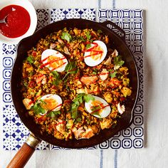 MIXED GRAINS, HOT SMOKED SALMON AND COCONUT OIL KEDGEREE | sheerluxe.com