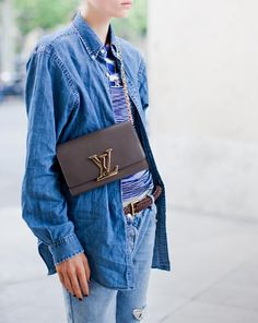 what-do-i-wear:  All denim again, it is a winner for summer. Also the Louis Vuitton bag, a new classic for sure, here worn casual chic cross body. This one is the Louise Chain bag seen on model Caroline Brasch Nielsen. (image: carolinesmode)