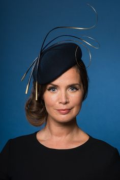 Dark navy felt headpiece adorned with black and gold dipped ornate quills Features Can be made in other colours. Just contact us to discuss. Secures via an invisible elastic Ideal for Ascot race…