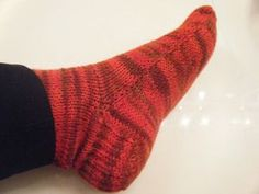 Knit socks on 2 straight needles. (Crochet the seam--it's invisible, it's amazing, IT'S EASY!)