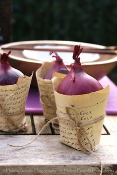 Red onion and vintage paper centerpiece <3 - HA, that's my color, but not sure I want onions on table.