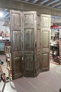 Reclaimed teak w/metal wrap on one side folding screen/room divider (BR) by Discoveries New Arrivals!, via Flickr