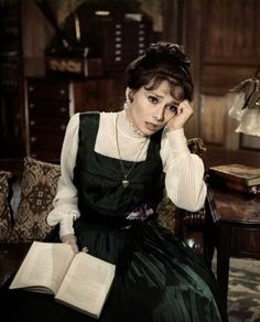 books0977: Eliza reading and frustrated with elocution. She then gets it… Eliza Doolittle (Audrey Hepburn, vocal by Marni Nixon) demonstrates her improved elocution to Professor Henry Higgins (Rex Harrison) in the Lerner and Loewe number, The Rain In Spain, in My Fair Lady, 1964.