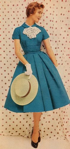 1950s dress in beautiful blue.  They don't make cute sleeved dresses like this anymore.