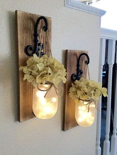 This is a set of 2 or 3 gorgeous and perfectly rustic chic mason jar wall sconces!  The wood has been stained and sanded to give it a worn distressed effect. The jars are lightly frosted which gives these sconces a soft romantic feel.  Each sconce measures 14 long and 5.5 wide and includes flower and fairy lights for each jar.   I ship priority with shipping and insurance included! :)