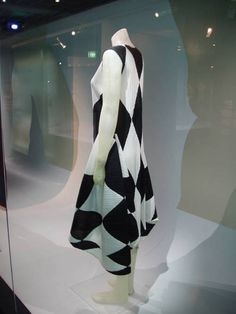 Issey Miyake dress made from pleated polyester, 2000  Created by sewing the black and white pieces of fabric together, then the garment is finely pleated.