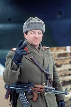 A Romanian solider gives the victory sign after the overthrow of dictator Nicolae Ceaușescu. He has removed the insignia of communist Romania from his headwear, 1989