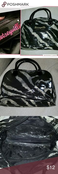 Betseyville zebra cosmetic bag ..❤ Pre ,loved but in good condition cosmetic bag that holds a ton of stuff as shown. 10 inches at the widest, 6 across bottom, , it from top to bottom. Betseyville Bags Cosmetic Bags & Cases