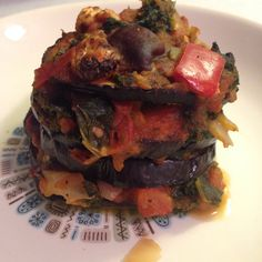 Vegan Eggplant stack! Bake sliced eggplant on a nonstick pan for 25 minutes on 425. Flip at 15. In wok cooked down to desired amount for meal planning- onions and hot peppers sautéed in water and lemon. Add tomatoes diced, chopped kale, chopped red pepper and shiitake mushrooms. Pepper, basil, oregano to taste. All cooked together for 30 minutes. Take eggplant out and layer with veggies.   Bake for 13 minutes on 325. #eattolive #vegandinner #mealplanning