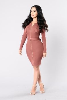 - Available in Dusty Rose - Knit Dress - Long Sleeve - Zip Up - Round Neckline - Front Pockets - Belted Waist - Knee Length - 70% Rayon, 30% Nylon