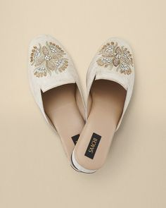 Elevate your lounge time with a silk linen-like slide with elaborate embroidery and beading so lovely, you