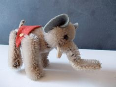 Jointed Miniature Mohair Elephant : Antique Steiff or Schuco Stuffed Animal Toy. $46.00, via Etsy.