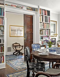 Dining/Library Room...great way to get use out of the dining room. Love pocket door and mix of fabric on chairs