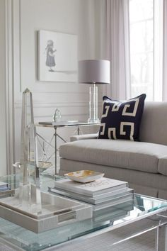 Jennifer Backstein Interiors: Chic and contemporary grey, white and navy living room.
