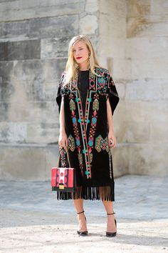 When a mass of Burberry blanket coats closed the Fall 2014 runway and embroidered boho Valentino versions stomped its Parisian catwalk last season, we had a hunch the poncho was about to reign supreme. These ladies proved us right. Pictured: Kate Foley in Valentino Diego Zuko   - HarpersBAZAAR.com