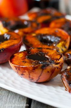 Grilled Balsamic Peaches - a reduction of molasses, balsamic vinegar and fresh black pepper is fabulous with the sweetness of grilled peaches!