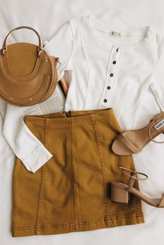 The Free People Modern Femme Golden Yellow Denim Mini Skirt is our new go-to! Super stretchy denim shapes this must-have mini skirt with exposed seams. Komplette Outfits, Skirt Outfits, Spring Outfits, Winter Outfits, Casual Outfits, Fashion Outfits, Ladies Outfits, Fashion Trends, Look Fashion