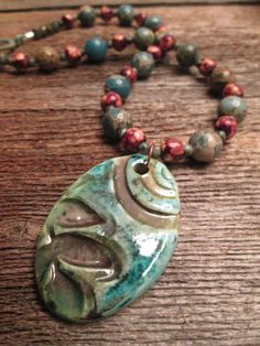 Green Hued Ceramic Pendant Necklace by CorinaCollectables on Etsy, $85.00