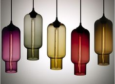 Perfect glass pendant lights to give a pop of color, with a nice classy look.
