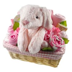 This deluxe baby floral arrangement contains everything needed for a special new one including blanket, natural babygrow, socks, washcloths, special baby toiletries, bibs and a beautiful baby girl Binky Bunny. The stunning arrangement is presented in a lined basket (which is great for nursery storage for nappies etc once the gift is used). Completed with gorgeous artificial flower and greenery detail and wrapped in cello.
