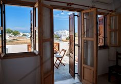 Bed & Breakfast in Perissa, Greece. Spacious and bright room with a private balcony offering a quiet, relaxed atmosphere with a panoramic view of the Aegean and the mountain.  Just a few minutes walk from the black sandy beach of Perissa, Almyra Villa offers spacious and bright lodg...