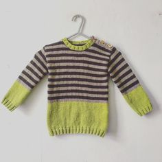 Hand knitted baby and toddler sweater pattern. Free pattern can be found here (0-5years): http://www.woolwarehouse.co.uk/blog/free-pattern-friday-06-november-2015/ Substituted red for pistachio green