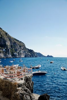 Experience the ultimate dining experience at Il Pirata, on the #AmalfiCoast, where a sun-drenched terrace is built into rocks above a glittering cove.