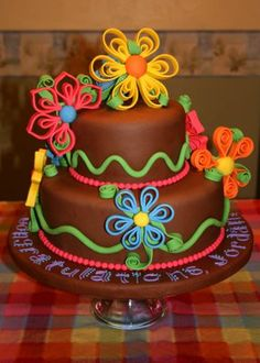 whimsical flowers cake ~ quilling with fondant... Opens up a whole world of possibilities, hmmm....