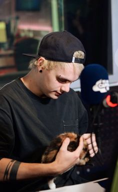 SnapBack Michael is one of my favorite kinds of Michaels<<<< He is also holding baby animals