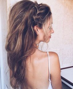 Braided crown and teased waves.