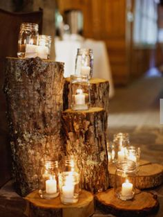candles in mason jars on tree stumps