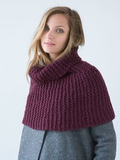 A cozy capelet is worked side-to-side in garter stitch. Short-row shaping helps hug the shoulders; cast-on and bind-off edges are grafted with Kitchener stitch in finishing. Capelet Knitting Pattern, Arm Knitting, Knitting Needles, Shawl Patterns, Crochet Patterns, Universal Yarn, Christmas Knitting Patterns, Wrap Pattern, Dress Gloves