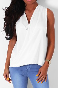 Pink Boutique Maggie May white #drape #top Update your wardrobe with this fab top. This style is made of stunning silky fabric, with folds and drapes beautifully at the front. This is a pull on style with no stretch. http://www.pinkboutique.co.uk/new-in/maggie-may-white-drape-top.html #pinkboutique