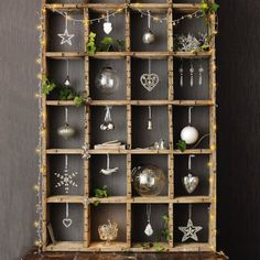I love this rustic old printer's box with shiny, elegant-looking baubles hung and placed in it...we could use old barnwood frames hung together with similar items grouped together