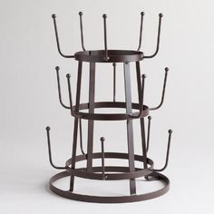Our lovely and durable Wire three-Tier Glass Drying Rack is great for drying, storing, and displaying up to 15 glasses at a time. The rack is made of tough, rustproof wire, and features three tiers to save counter space and leave your kitchen distinctively organized. A convenient and elegant value that looks beautiful on a countertop.