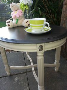 Beautiful French style coffee table painted with Annie Sloan chalk paint in the 'County Grey' shade then sympathetically distressed and a clear wax finish. The top has been painted in the ' Graphite ' shade then finished with dark wax. Available through eBay. Another beautiful piece by Chic Boutique Furniture in Leicester.