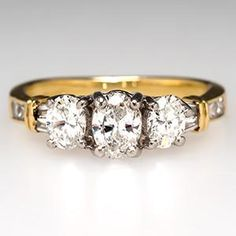"""""""THREE-STONE ENGAGEMENT RING W/ OVAL BRILLIANT DIAMONDS IN 18K GOLD & PLATINUM."""" 11 stones, 1.02 carats total."""