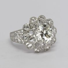 Unique round brilliant cut diamond engagement ring with rose cut pear shaped diamonds by Oliver Smith Jeweler.