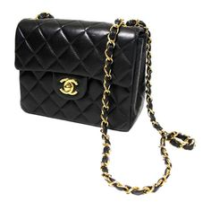 Chanel Mini Classic | From a collection of rare vintage handbags and purses at https://www.1stdibs.com/fashion/handbags-purses-bags/