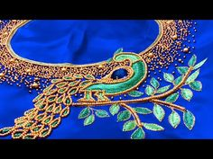 This video is a short explanation about bead embroidery in saree blouses. I have also explained about how to make a beautiful peacock motif with beads and th. Peacock Blouse Designs, Peacock Embroidery Designs, Kids Blouse Designs, Wedding Saree Blouse Designs, Pattu Saree Blouse Designs, Blouse Designs Silk, Peacock Design, Hand Designs, Hand Work Embroidery