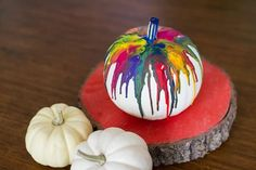 Anyone else getting your pumpkin decorating on? Last weekend I made the most fun and colorful DIY crayon drip pumpkin, and I wanted to share the tutorial with… Pumpkin Flower, Pumpkin Topiary, Pumpkin Candles, Diy Pumpkin, Pumpkin Ideas, Pumpkin Crayon, Fake Pumpkins, Painted Pumpkins, Fabric Pumpkins