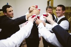 Wedding day gift ideas for your groom! Box filled with ring pop, socks (in case of cold feet), whiskey, mini solo cup shot glasses for groomsmen. Groomsmen toast before the wedding!  http://www.neverseriousblog.com/the-perfect-day-wedding-recap-part-1-2/