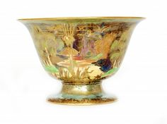 Daisy MAKEIG-JONES, Wedgwood - A Fairyland Lustre pedestal bowl, the interior decorated in the Woodland Elves / Spiders Web pattern and the interior decorated in the Woodland Bridge pattern, green printed and gilt Portland Vase mark, H. 13cm, diam. 21cm. (hva)