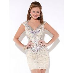 The House of Wu Hannah S 27895 short dress features a sheath silhouette draped entirely with Venice lace overlay. Colorful chunky beadwork stretches from top to hem, with extra concentration along the modified Queen Anne neckline and hip area. The cap sleeves lead into the elliptical cutout back. This fully-beaded dress tapers through the mid-thighs with a pencil skirt.