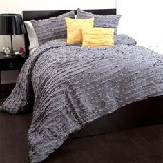 """Ruffled comforter set with hand-sewn detailing.   Product: 1 Comforter, 2 pillow shams, and 2 decorative pillows Construction Material: 100% PolyesterColor: Gray and yellowFeatures: Inserts included with decorative pillowsDimensions: Queen Comforter: 90"""" x 92""""King Comforter: 92"""" x 104""""Note: Inserts not included with shams"""