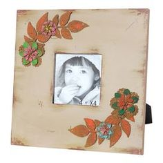 "Grey picture frame with a warmly weathered finish and floral detail.     Product: Picture frameConstruction Material: Wood, metal and glassColor: GreyFeatures: Holds one 4"" x 4"" photoDimensions: 9.75"" H x 9.75"" W x 1"" D"