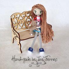 Amigurumi doll sitting on a bench. (Inspiration).