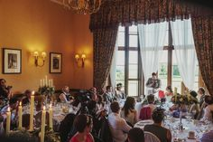Wedding speeches lit by candlelight in the terrace rooms.  Wedding photography at Matfen Hall by 2tone Photography. www.2tonephotography.co.uk
