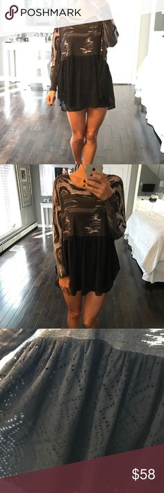 Free People Boho Coachella flowy top XS shirt Black with white and grey at the top. Beautiful flowy perforated bottom. Bottom closure at the top back of the neck. Size XS Free People Tops